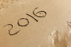 Nuovo anno 2016 sulla sabbia Fotografia Stock Libera da Diritti