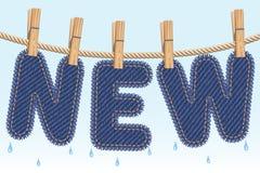 NUOVO essiccamento dei jeans su un clothesline Fotografia Stock