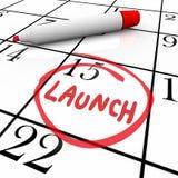 Nuovo prodotto di debutto del calendario circondato parola del lancio Immagini Stock