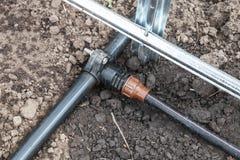Nuovo sistema dell'irrigazione a goccia in serra Immagini Stock
