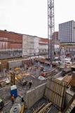 Nuovo sito della costruzione di edifici con la gru Fotografie Stock Libere da Diritti