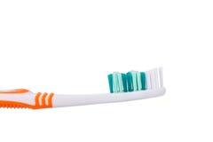 Nuovo spazzolino da denti arancio Colpo dello studio isolato su bianco Fotografia Stock