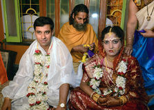 Nuptial Knot. Kolkata, West Bengal, India -The tying of the nuptial knot in traditional Bengali style entails a series of elaborate and colorful rituals, which stock photography