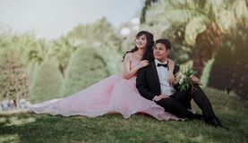 Nuptial Photo of Man in Black Formal Suit and Woman in Pink Gown stock image