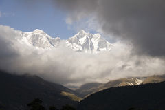 Nuptse and Lhotse in Nepal. View of Nuptse and Lohtse from Tengboche, Nepal. I'm not certain, but think you may be able to see the summit of Everest just beyond Royalty Free Stock Photo
