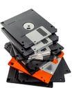 Nur eine orange Diskette in der Reihe Stockbild