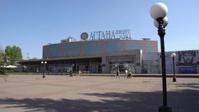 Nur-Sultan concert hall. Nur-Sultan Astana concert hall main gate entrance view with walking people on a sunny blue sky day stock video