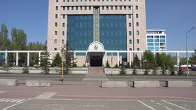 Nur-Sultan government building. Nur-Sultan Astana government building of the republic of Kazakhstan frontal view on a sunny blue sky day stock footage