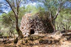 A nuraghe in the nuragic sanctuary of Santa Cristina, near Oristano, Sardinia, Italy. A nuraghe, an ancient megalithic edifice, in the nuragic sanctuary of Santa royalty free stock photos
