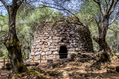 A nuraghe in the nuragic sanctuary of Santa Cristina, near Orist. A nuraghe, an ancient megalithic edifice, in the nuragic sanctuary of Santa Cristina, near Royalty Free Stock Photo