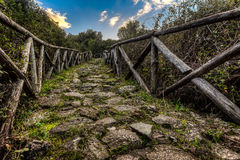 Nuraghe Riu mulinu. The path to the nuraghe stock photography