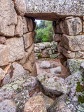 Nuraghe wall, Arzachena, Sardinia. Ancient stone walls in the Nuraghe Albucciu, the mysterious main type of ancient megalithic construction found in Sardinia Royalty Free Stock Images