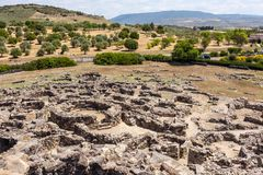 Nuragic ruins of the archaeological site of Barumini in Sardinia. On the background of the countryside royalty free stock photos