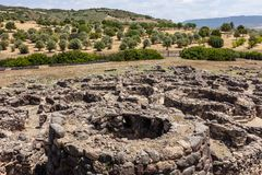 Nuragic ruins of the archaeological site of Barumini in Sardinia. With a round tower stock photography