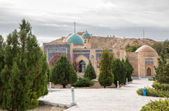 Nurata, Uzbekistan. Mosque and fortress. Namazgokh and Djuma mosque against the backdrop of the ruins of the fortress Nur. Nurata, Uzbekistan Royalty Free Stock Image