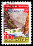 Nurek Hydroelectricity on the Vakhsh, October revolution serie, circa 1974. MOSCOW, RUSSIA - OCTOBER 21, 2018: A stamp printed in USSR (Russia) shows Nurek stock images