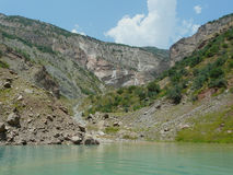 Nurek reservoir. The Nurek hydropower plant on the Vakhsh river in Tajikistan. View of the falls Royalty Free Stock Images