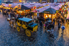 Nuremberg, Germany-Christmas Market- stagecoach tour. Christmas Market (Christkindlesmarkt) - yellow stagecoach tour, lot of people, stalls-Nuremberg (Nuernberg Royalty Free Stock Photos