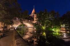 Nuremberg, Germany- city wall-river Pegnitz-night scenery. Nuremberg by night, Germany-old town city wall with arch-Kettensteg iron bridge, river Pegnitz Royalty Free Stock Images