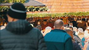 Nuremberg, Germany - December 1, 2018: A crowd of people walking between the stalls on the Christmas market. Nuremberg`s. Nuremberg, Germany - December 1, 2018 stock video