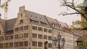 NUREMBERG, GERMANY - November 30, 2019: Left to right pan real time establishing shot of houses in the old town of. Nuremberg, November 30, 2019 in Nuremberg stock video