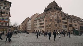 NUREMBERG, GERMANY - November 30, 2019: Locked down real time establishing shot of people walking on the square in. Nuremberg, November 30, 2019 in Nuremberg stock footage