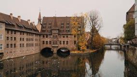 NUREMBERG, GERMANY - November 30, 2019: Real time establishing shot of Monastery Holy Spirit on the river Pegnitz stock video