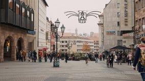 NUREMBERG, GERMANY - November 30, 2019: Real time establishing shot of people walking around the old town of Nuremberg stock video footage