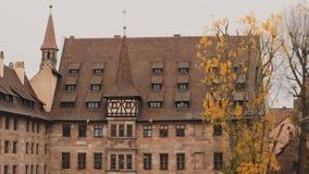 NUREMBERG, GERMANY - November 30, 2019: Real time medium shot of Monastery Holy Spirit on the river Pegnitz. Tilt down stock video footage
