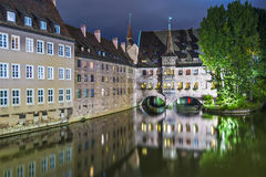 Nuremberg, Germany on the Pegnitz River. Nuremberg, Germany at the historic Hospital of the Holy Spirit on the Pegnitz River Stock Image