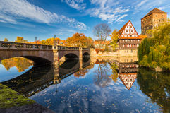 Nuremberg-Germany-river Pegnitz-autumn mirror cityscape. Colorful, sunny autumn-old town-Nuremberg (Nuernberg)-mirror image, Maxbruecke bridge, typical german Royalty Free Stock Image