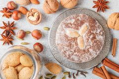 Nuremberg gingerbread with nuts almonds, hazelnuts, walnuts in sugar glaze. Lebkuchen. Traditional Christmas and new year treats. Cinnamon, anise and cardamom royalty free stock photography
