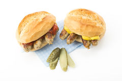 Nuremberg grilled sausages, roll and mustard, ketchup and gherkin Royalty Free Stock Photography