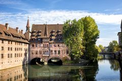 Free Nuremberg, Heilig-Geist-Spital Which Is Reflected In The Waters Of The Pegnitz River. Franconia, Germany Royalty Free Stock Image - 130569616