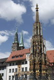 Nuremberg marketplace. Nurnberg marketplace represented by the detail of Beutiful fountain in the forefront and the spires of St. Sebaldus hhurch royalty free stock photography