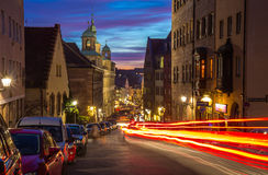 Nuremberg (Nuernberg), Germany-evening cityscape - traffic light. Nuremberg (Nuernberg), Germany-traffic red orange  light on long time exposure, historic Royalty Free Stock Photo