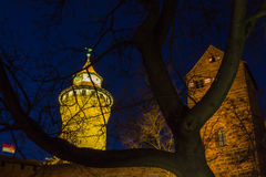 Nuremberg (Nuernberg), Germany-night old town-Imperial Castle. Illuminated Tower of Senses (Turm der Sinne), red-white flag of Franconia (Franken), northern Royalty Free Stock Photos