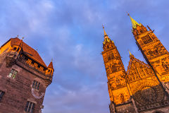 Nuremberg (Nuernberg), Germany-tops historic buildings. On blue sky- St.Lawrence (Lorenzkirche) gothic church, Nassau House (Nassauer Haus)-medieval residential stock photography