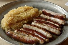 Nuremberg sausages with sauerkraut. Stock Photos