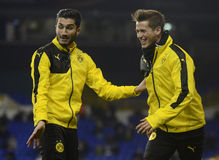 Nuri Sahin and Erik Durm. Football players pictured prior to the UEFA Europa League round of 16 game between Tottenham Hotspur and Borussia Dortmund on March 17 Stock Photo