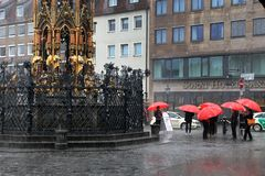 NURNBERG, GERMANY - JULY 13 2014: Rainy Day. Hauptmarkt, the cen. Tral square of Nuremberg, Bavaria, Germany.  Nuremberg accommodates annually more than 2 Royalty Free Stock Photo