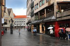 NURNBERG, GERMANY - JULY 13 2014: Rainy Day. Hauptmarkt, the cen. Tral square of Nuremberg, Bavaria, Germany.  Nuremberg accommodates annually more than 2 Stock Photo