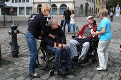 NURNBERG, GERMANY - JULY 13 2014: Tourists in wheelchairs on Hau Stock Photos