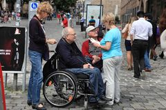 NURNBERG, GERMANY - JULY 13 2014: Tourists in wheelchairs on Hau Stock Images