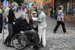 NURNBERG, GERMANY - JULY 13 2014: Tourists in wheelchairs on Hau Royalty Free Stock Image