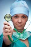 Nurse. Showing stethoscope on blue background royalty free stock photos