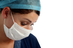Nurse. Serious looking nurse with cap and mask Royalty Free Stock Photo