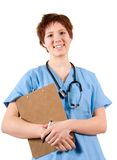 Nurse. Smiling nurse in blue scrubs on white background Royalty Free Stock Photos