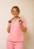 Nurse. A smiling nurse in her scrubs with her stethescope Stock Images