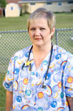 Nurse. Dressed in scrub top with stethoscope around neck standing outdoors Royalty Free Stock Photos